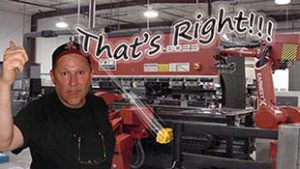 image - photo of Robert in front of a press brake machine
